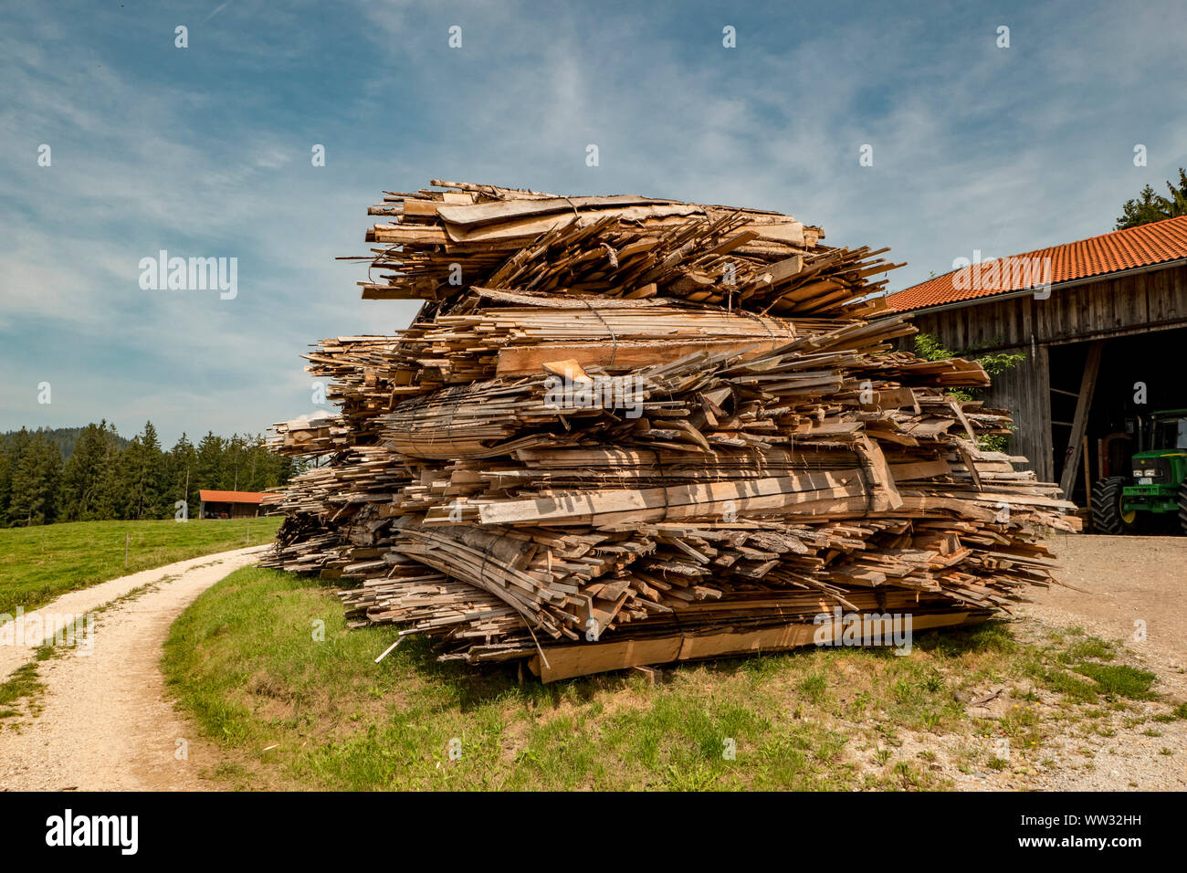 cut and stacked wood in planks cut on a meadow Stock Photo