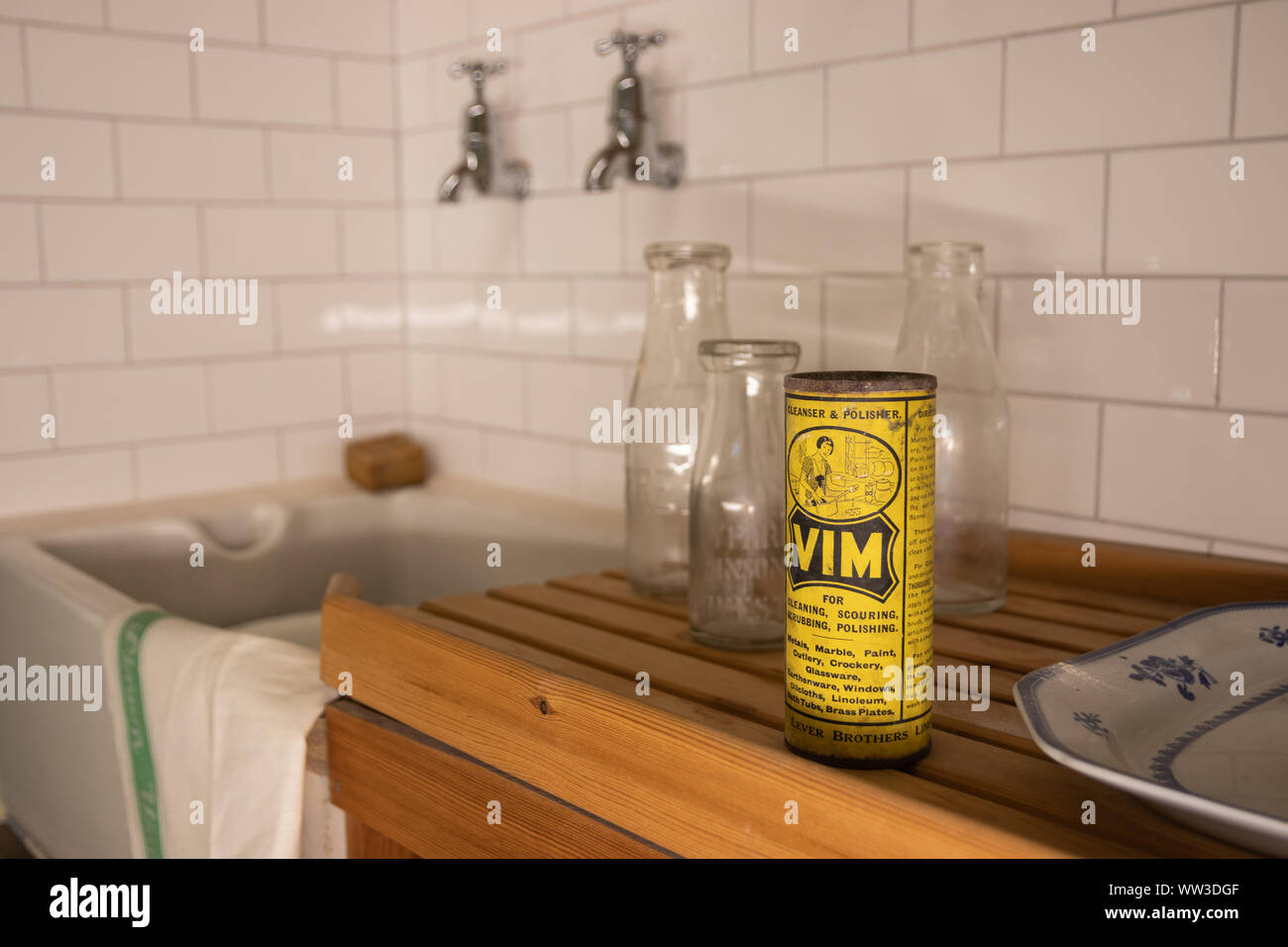 A scene from a 1960\'s kitchen with tiles, a butler sink ...