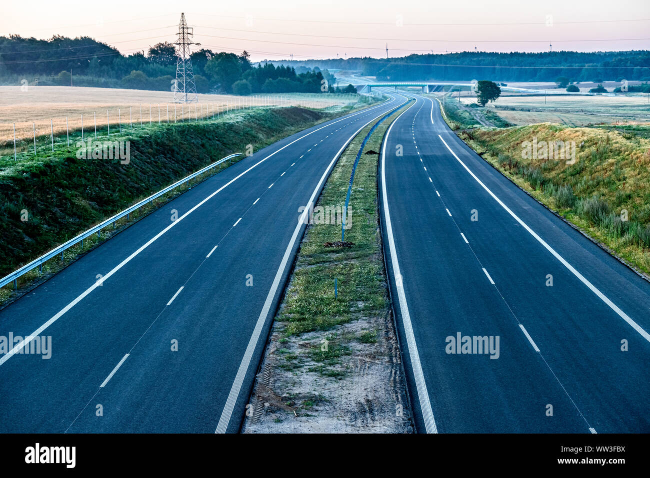 empty two-lane road stretching out into the horizon Stock Photo