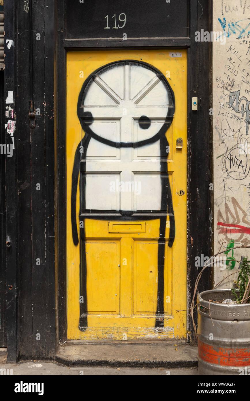 Stickman graffiti art painted on door in Shoreditch, East End, London, England, UK Stock Photo