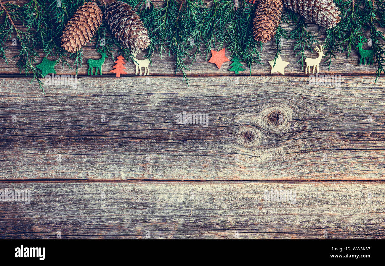 Festive objects of New Year and Christmas on a wooden background. Stock Photo