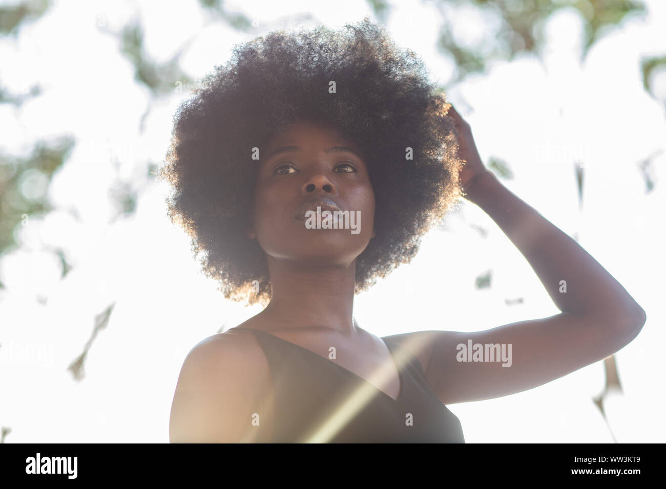 Young african american woman shot from below, confident look, determined Stock Photo