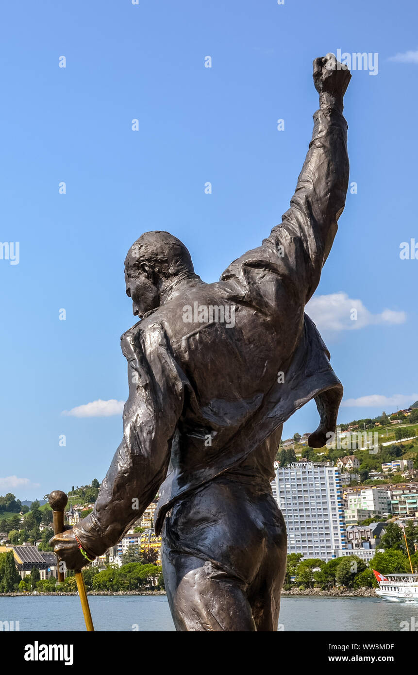 Montreux, Switzerland - July 26, 2019: Famous statue of Freddie Mercury, singer of the famous band Queen. City by Lake Geneva in background. Popular tourist landmark. Freddy Mercury, Farrokh Bulsara. Stock Photo