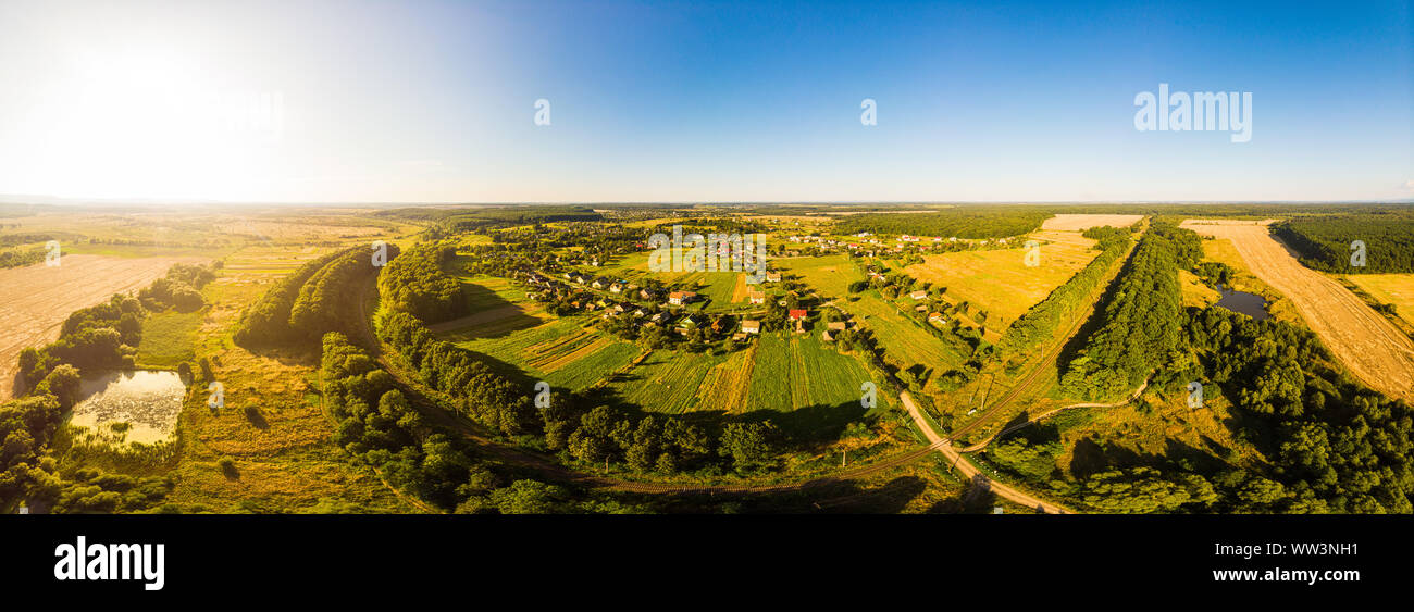 Aerial drone view of traditional Ukrainian village. 180 degrees panoramic landscape of rural area, Verkhni Hai village, Western Ukraine. Stock Photo
