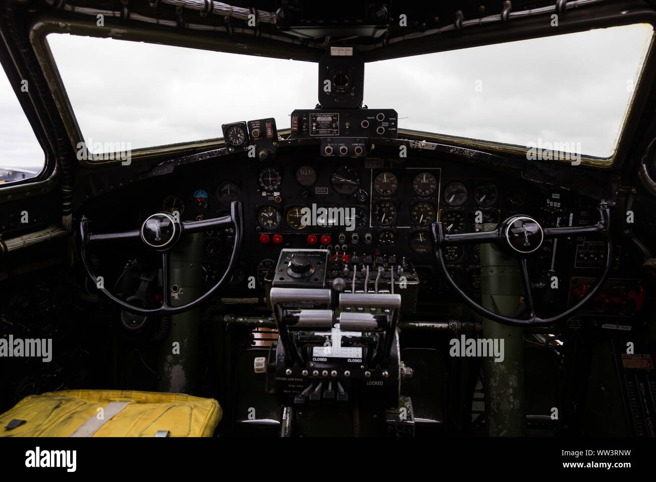 "The cockpit of ""Texas Raiders,"" an authentically restored WWII B-17G Flying Fortress Bomber sitting on static display at the Fort Wayne Airshow. Stock Photo"