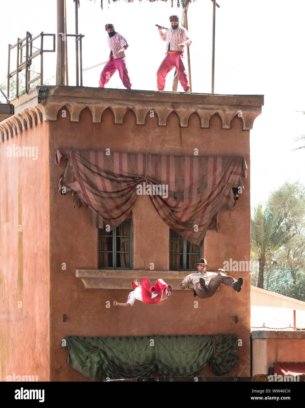 Indiana Jones Epic Stunt Spectacular! Indy and Marion are photographed in mid-fall in leap off of a Cairo rooftop. Stock Photo