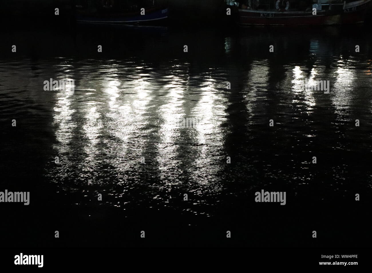 Reflections in water of harbour Stock Photo