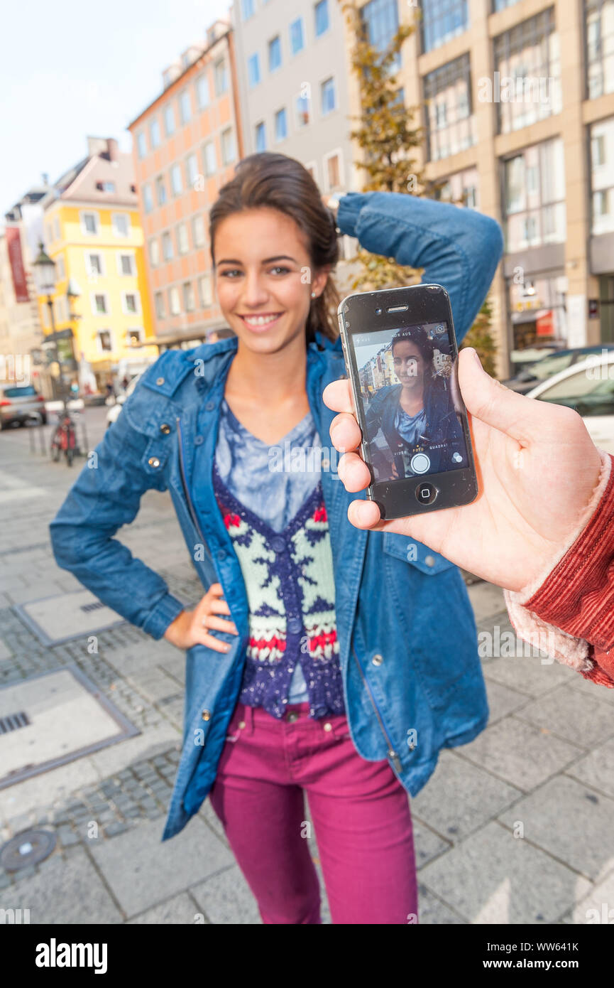 Young woman can be photographed with smartphone Stock Photo