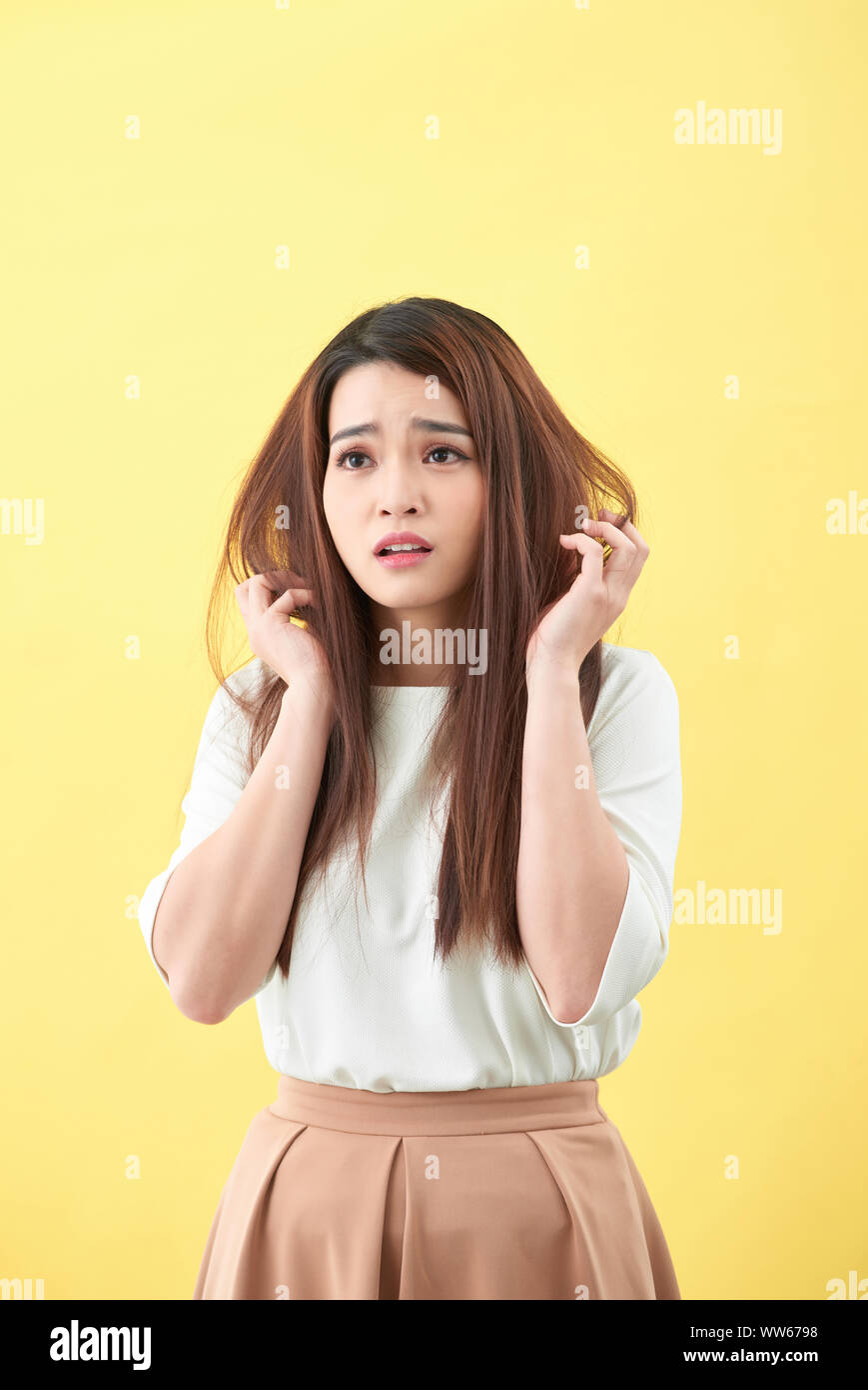 Young woman having hair problems Stock Photo