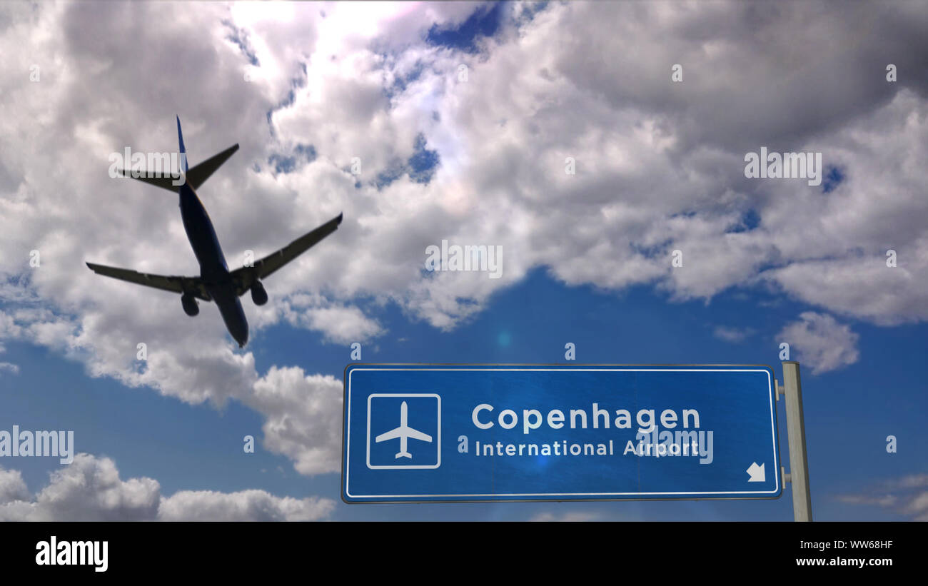 Airplane Silhouette Landing In Copenhagen Denmark Europe City Arrival With International Airport Direction Signboard And Blue Sky In Background Tr Stock Photo Alamy