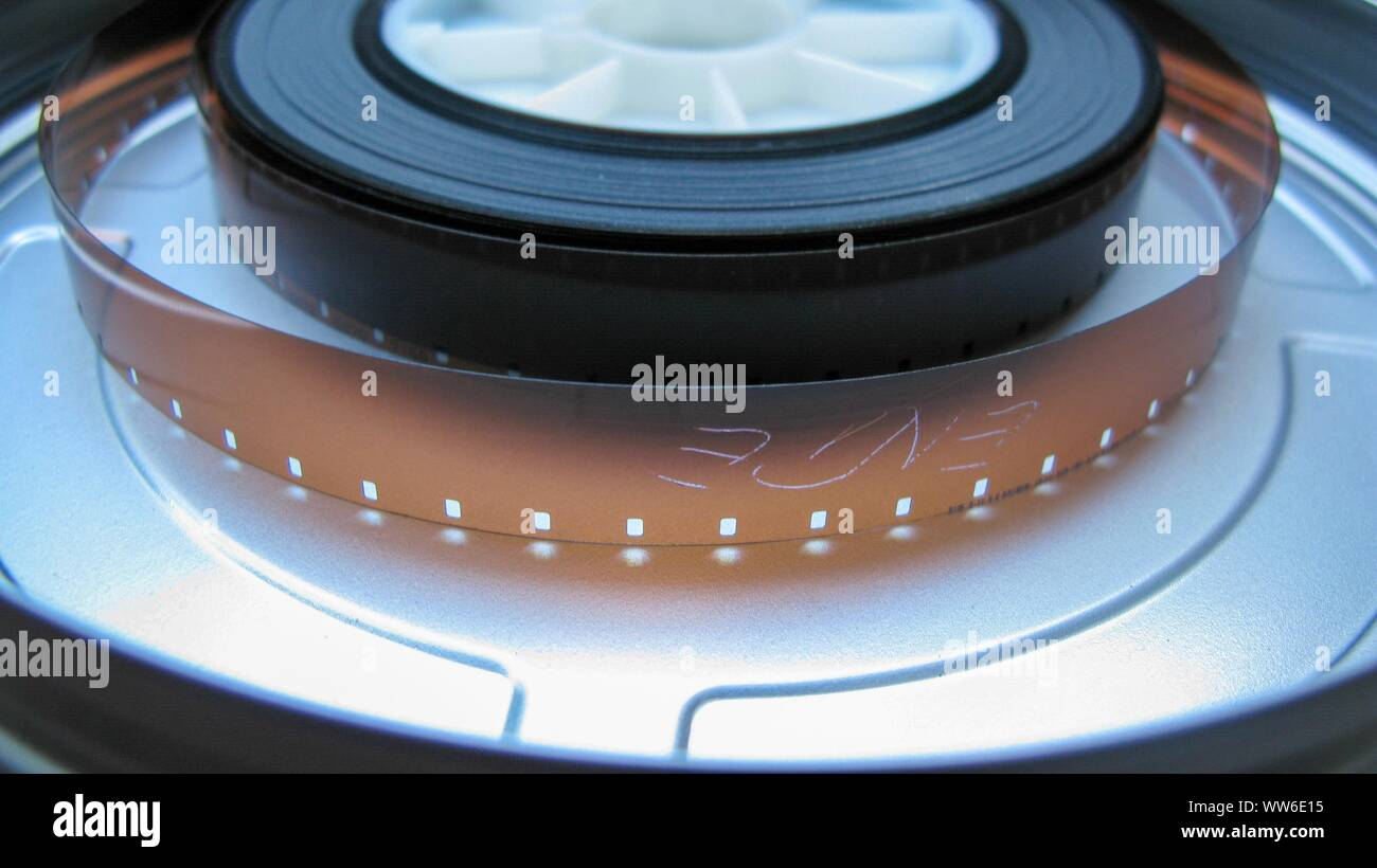 Roll of developed Super 16mm Film Negative on a Bobby in a can. 16mm Film is a popular and economical gauge of film stock. Stock Photo