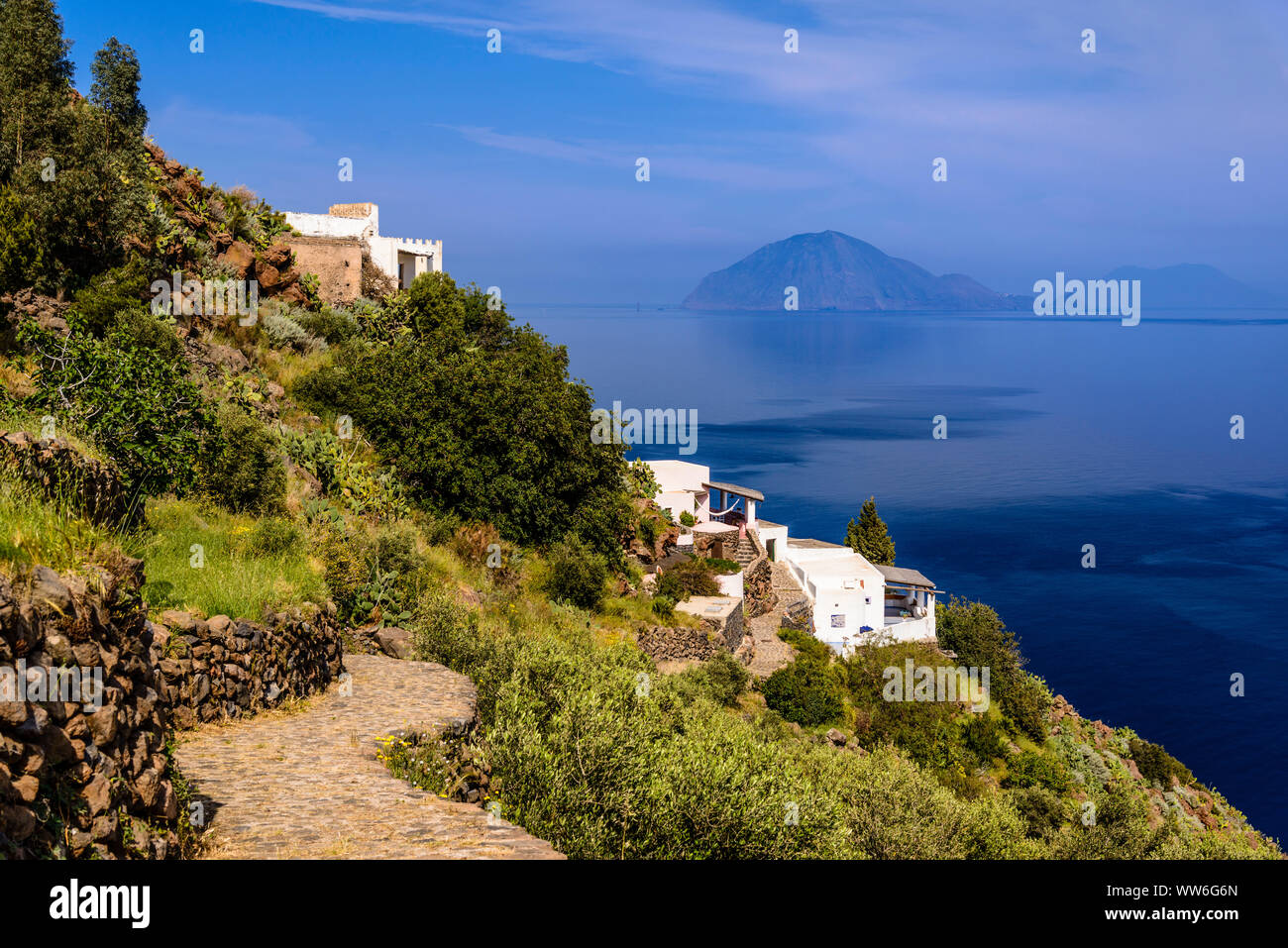 Italy, Sicily, Aeolian Islands, Alicudi, view at San Bartolo against Filicudi Stock Photo