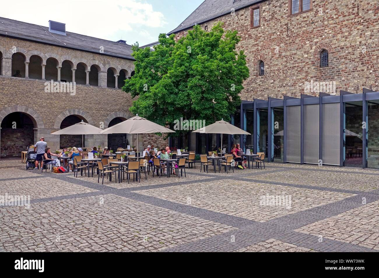 Café in the courtyard of the Simeonstift City Museum, Simeonstift Square, Trier, Rhineland-Palatinate, Germany Stock Photo