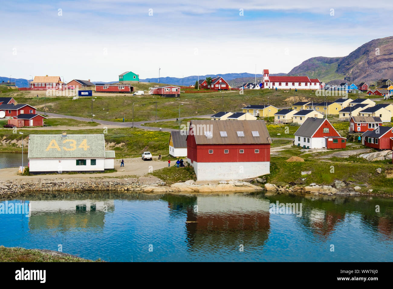 View across the bay to the museum buildings in Narsaq, Kujalleq, South Greenland Stock Photo