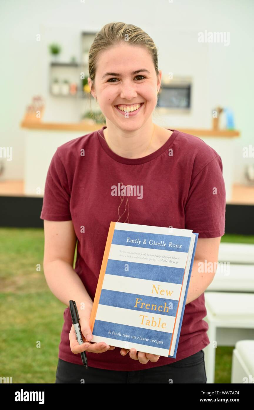 """Emily Roux. Pictured with the book that she wrote with her mother Giselle """"New French Table"""". The Kitchen, Tower of London Food Festival, Tower of London, London. UK Stock Photo"""
