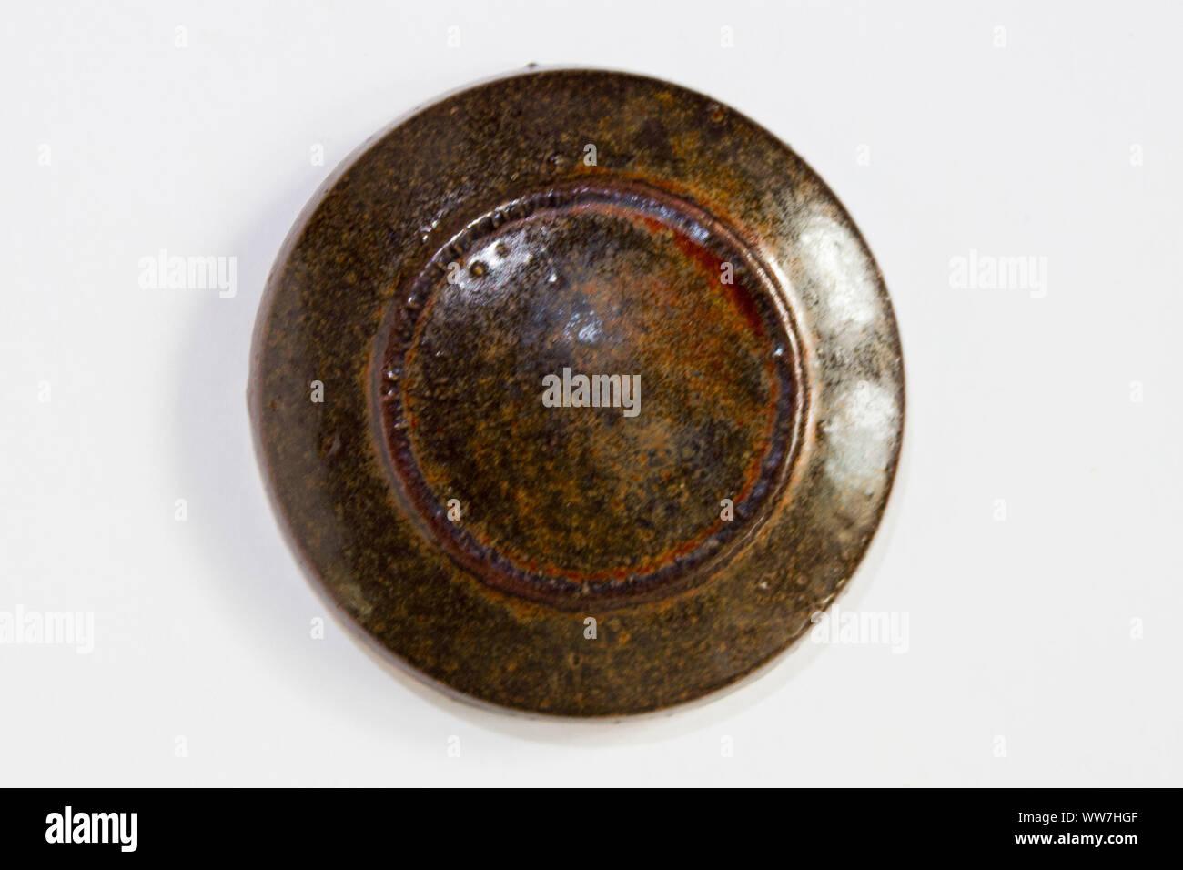 round clay probe with brown glossy glaze Stock Photo