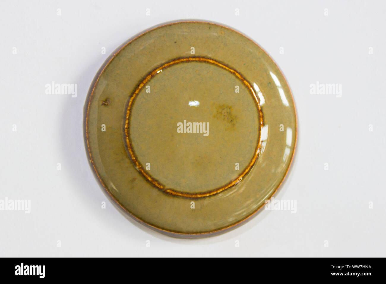 round clay probe with tobacco glossy glaze Stock Photo