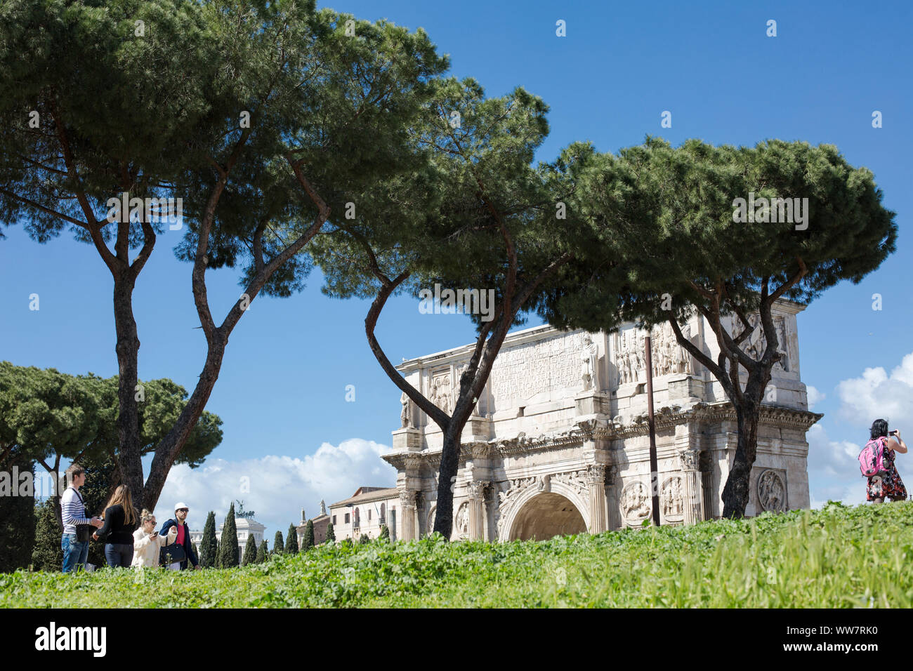 Italy, Rome, people walking along a way to the Coliseum, in the background Meta Sudans Stock Photo