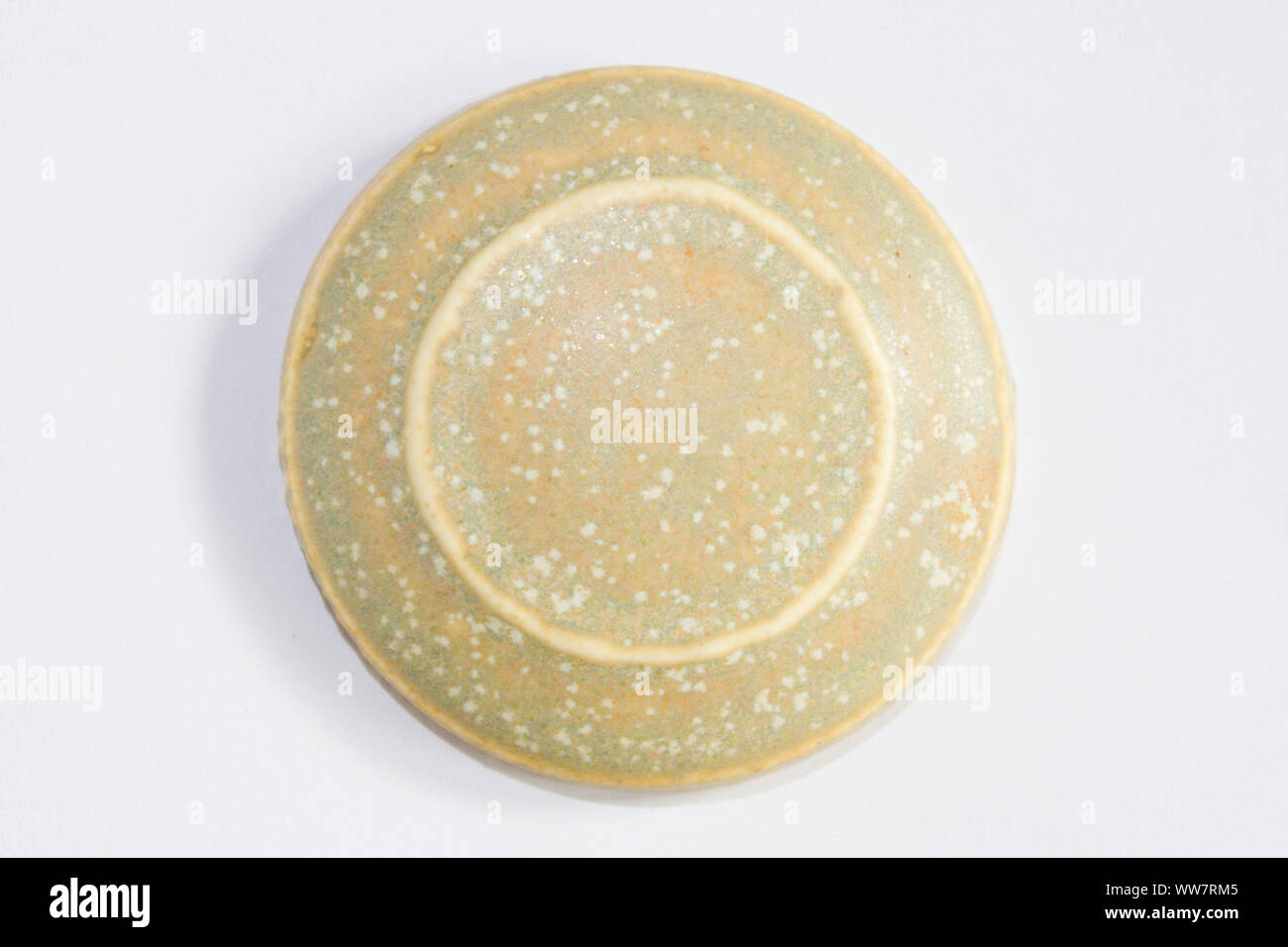 round clay sample covered with beige matte glaze Stock Photo