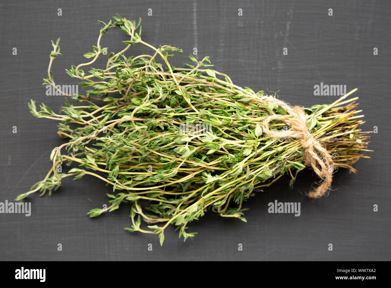 Raw organic fresh thyme on a black  background, side view. Closeup. Stock Photo