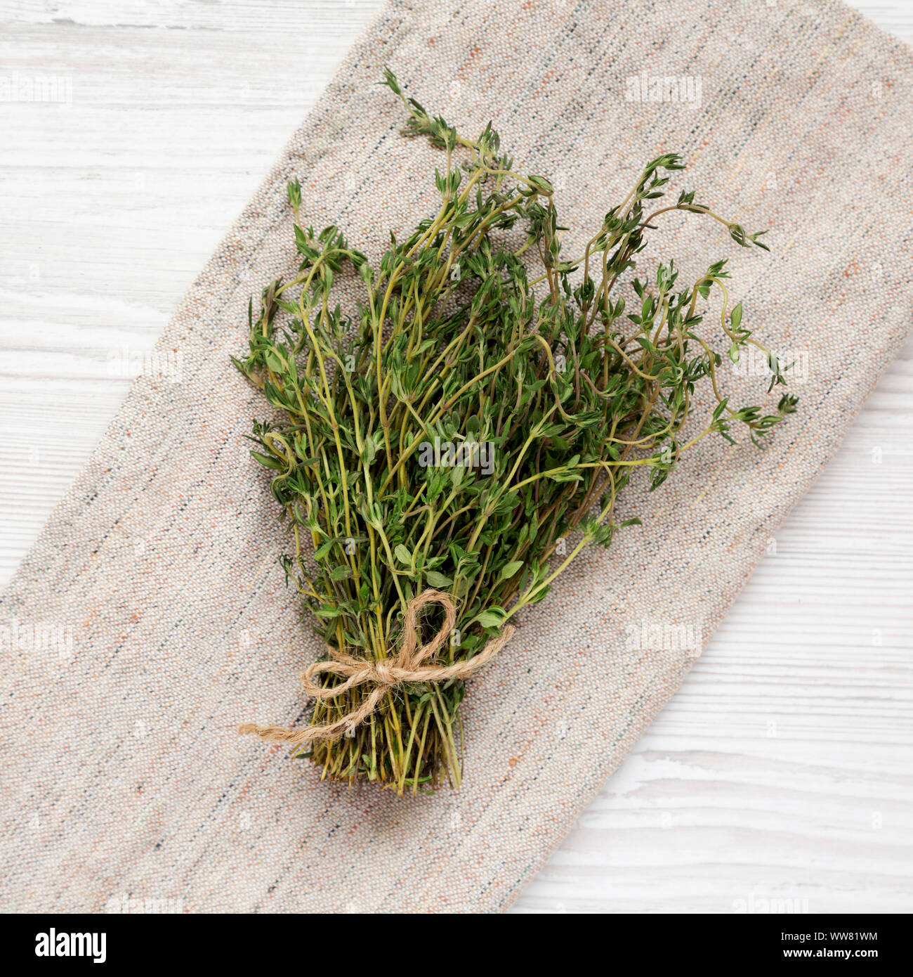 Top view, raw organic fresh thyme on cloth. Flat lay, overhead, from above. Close-up. Stock Photo