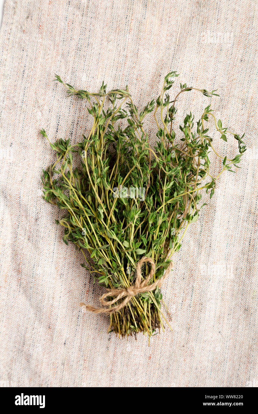 Raw organic fresh thyme on cloth, top view. Flat lay, overhead, from above. Close-up. Stock Photo