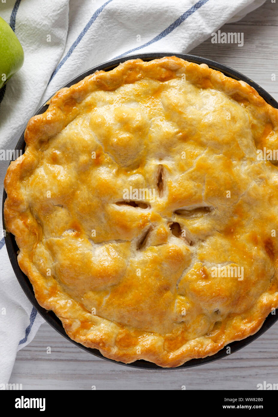 Homemade apple pie on a white wooden background, top view. Flat lay, overhead, from above. Close-up. Stock Photo