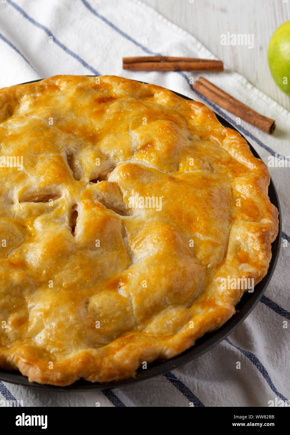 Homemade apple pie on cloth, side view. Close-up. Stock Photo