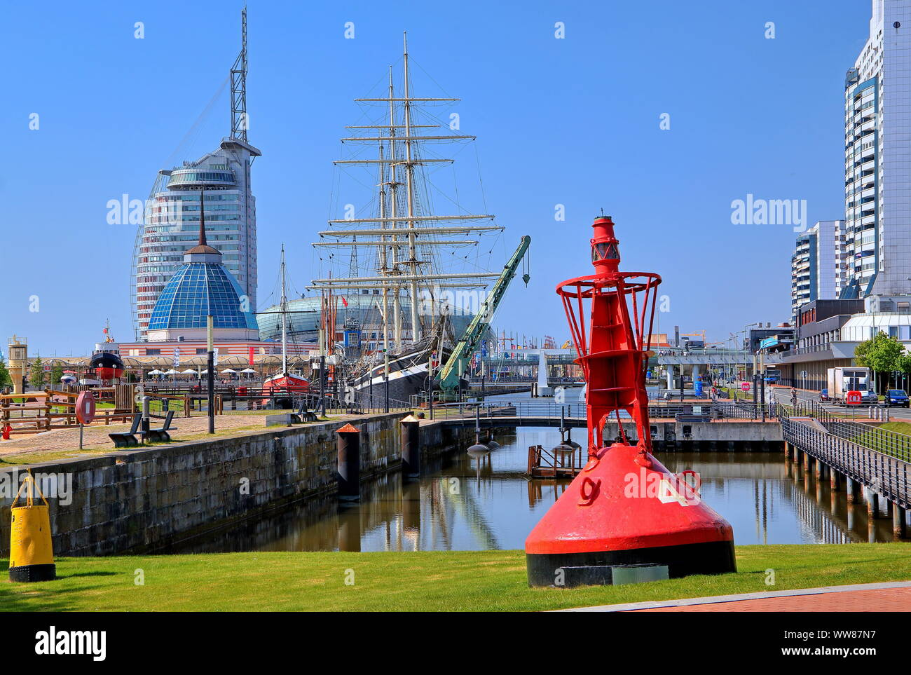 Seamark, red buoy at the old harbour with sailing ship Seute Deern, Bremerhaven, Weser estuary, Bremen state, North Germany, Germany Stock Photo