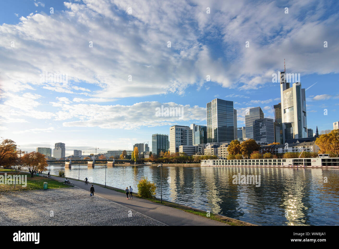 Frankfurt am Main, river Main, skyscrapers and high-rise office buildings in financial district, Commerzbank Tower, cruise ship, Hessen (Hesse), Germany Stock Photo