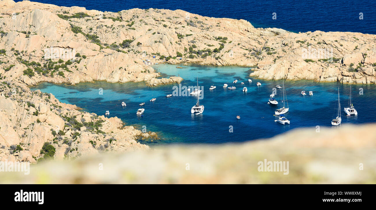 (Selective focus) Stunning aerial view of Cala Coticcio also known as Tahiti with its rocky coasts and small beaches bathed by a turquoise clear water Stock Photo