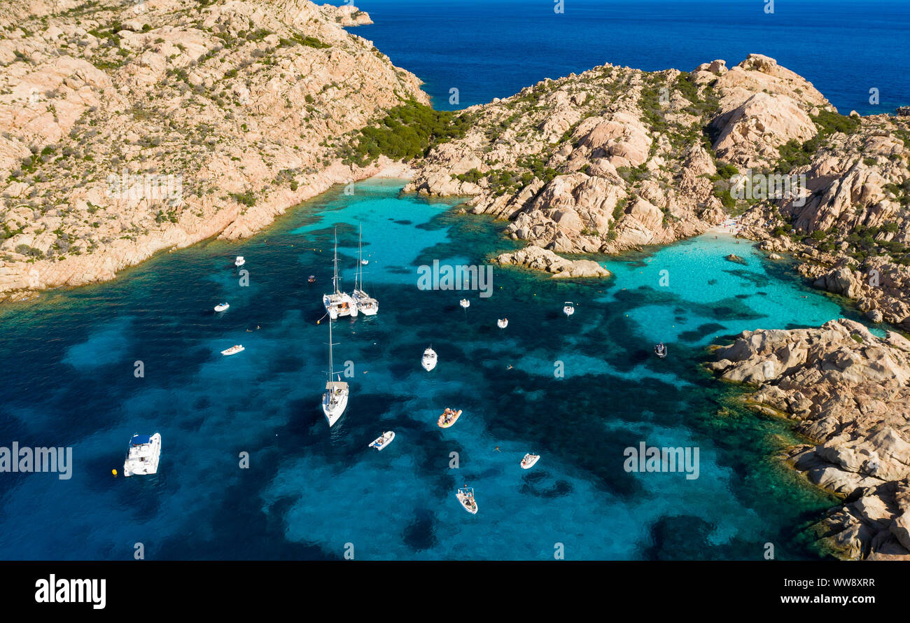 View from above, Stunning aerial view of Cala Coticcio also known as Tahiti with its rocky coasts and small beaches bathed by a turquoise clear water. Stock Photo