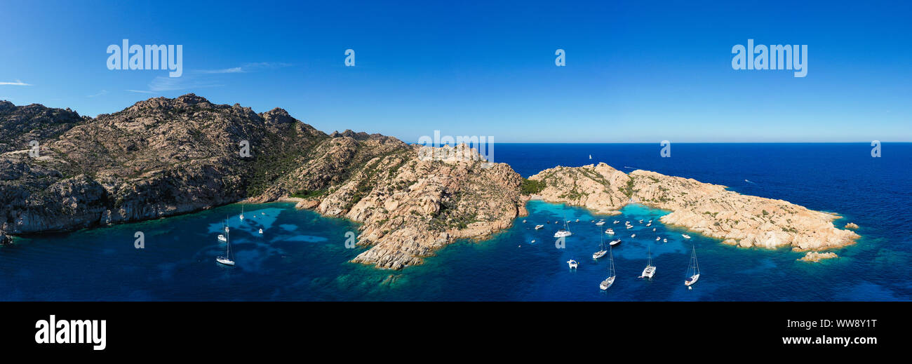 Stunning panoramic view of Cala Coticcio also known as Tahiti with its rocky coasts and small beaches bathed by a turquoise cllear water. Stock Photo