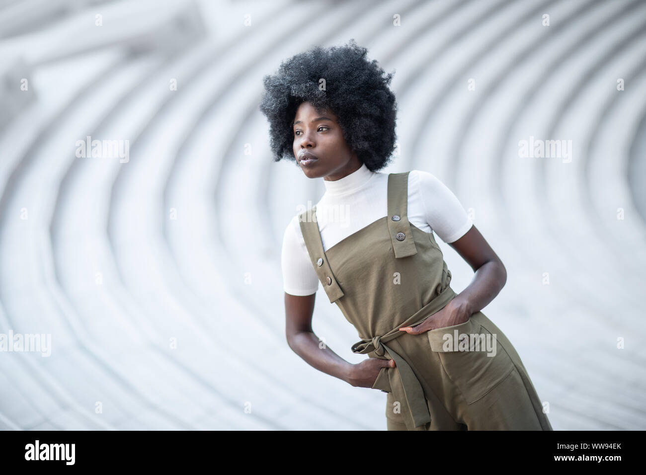 Young and beautiful black girl on an urban landscape, creative fashion shot, stairs. Stock Photo