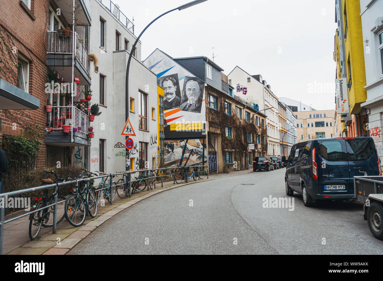 Street art and chained bicycles line the suburban streets of Altona, Hamburg, on a quiet grey winters morning Stock Photo