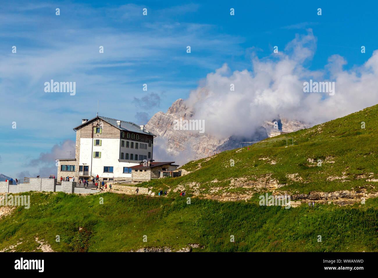 Auronzo alpine hut near the Three Peaks of Lavaredo, in the back Monte Campedelle and Col de le Bisse, Sexten Dolomites Stock Photo
