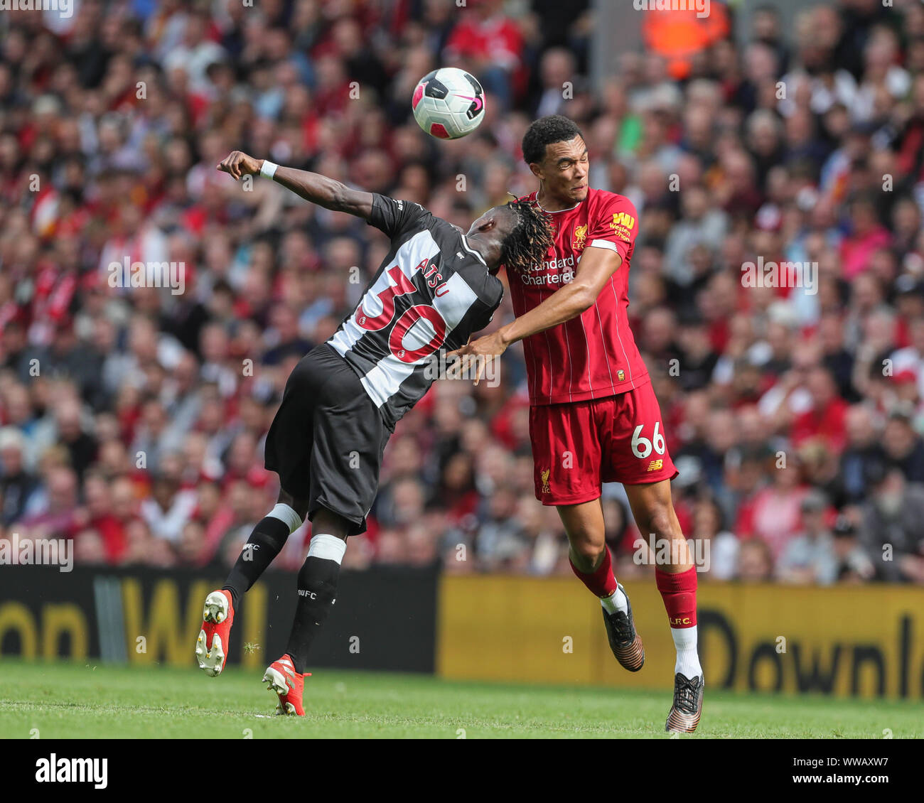 14th September 2019 , Anfield, Liverpool, England; Premier League Football,  Liverpool vs Newcastle United ; Trent Alexander-Arnold (66) of Liverpool  and Christian Atsu (30) of Newcastle United dual for the ball Credit: