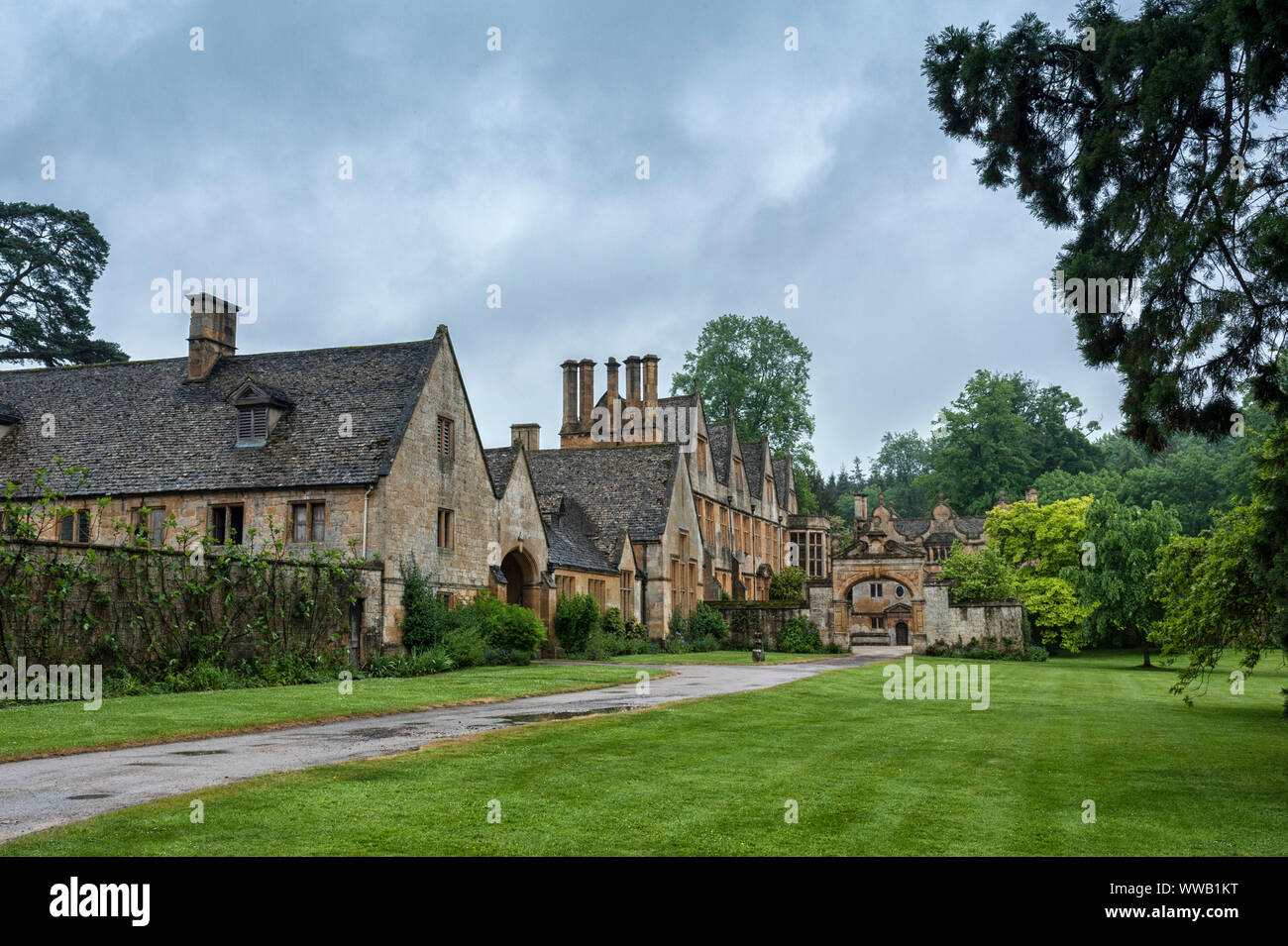Stanway Manor House built in Jacobean period architecture 1630 in guiting yellow stone, in the Cotswold village of Stanway, Gloucestershire, Cotswolds Stock Photo