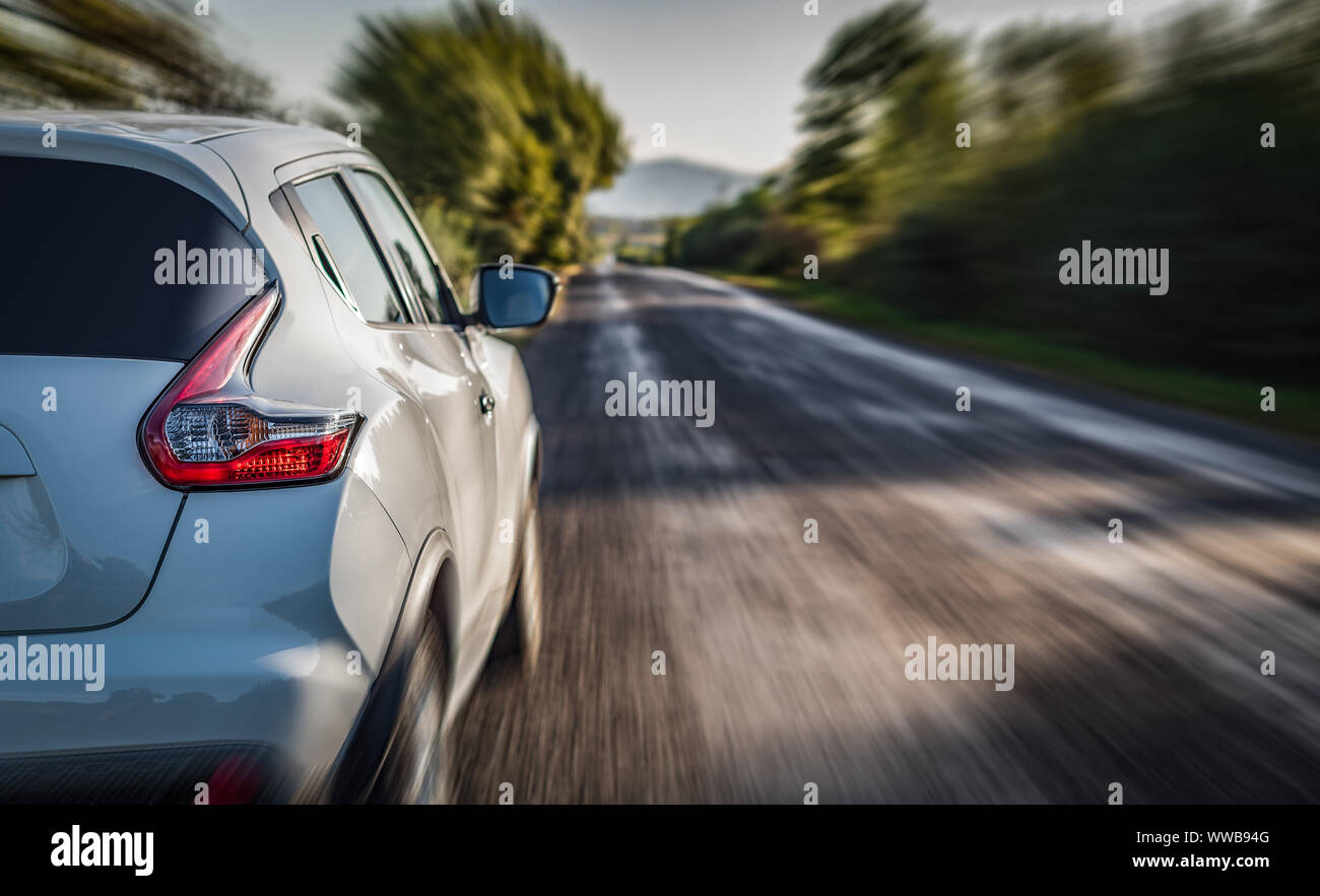A white car on the road. Stock Photo