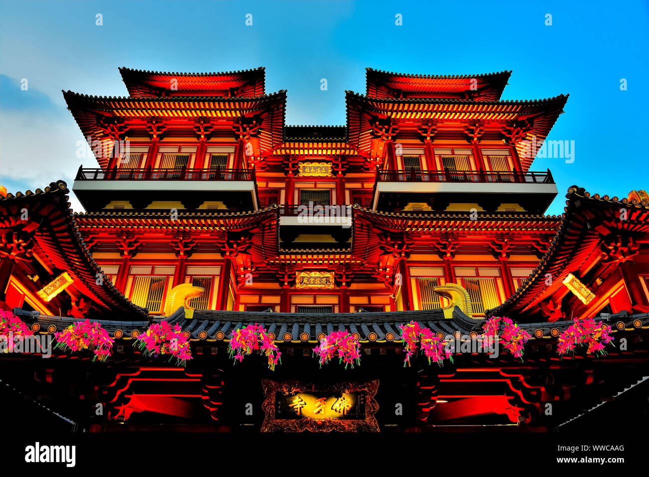 Exterior of Buddha Tooth Relic Temple in Chinatown, Singapore at evening blue hour and lit for Chinese New Year Stock Photo
