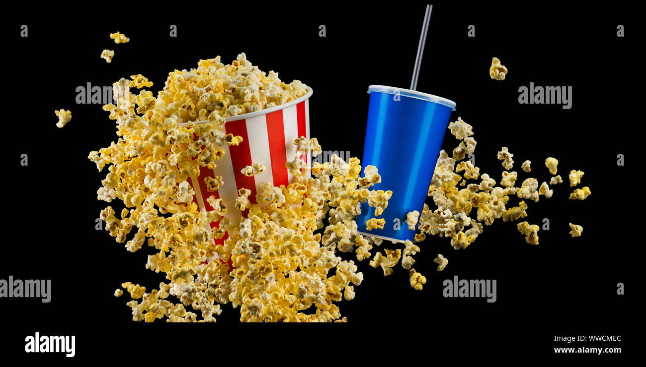 Set of paper striped bucket with popcorn and cup of soft drink isolated on black Stock Photo