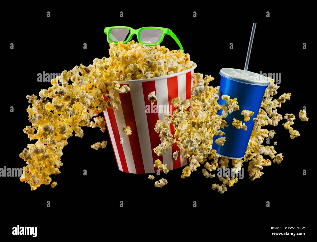 Paper striped bucket with popcorn, cup of drink and glasses isolated on black Stock Photo
