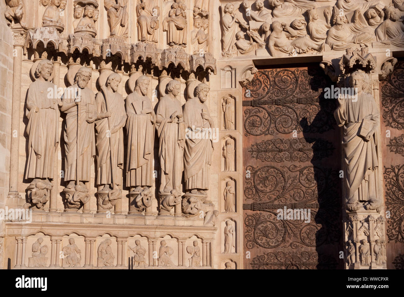 Notre Dame de Paris cathedral, Paris, France. Closeup  ébrasement of  the  Portal of the Last Judgement (main gate). Statues of apostles and Jesus Stock Photo