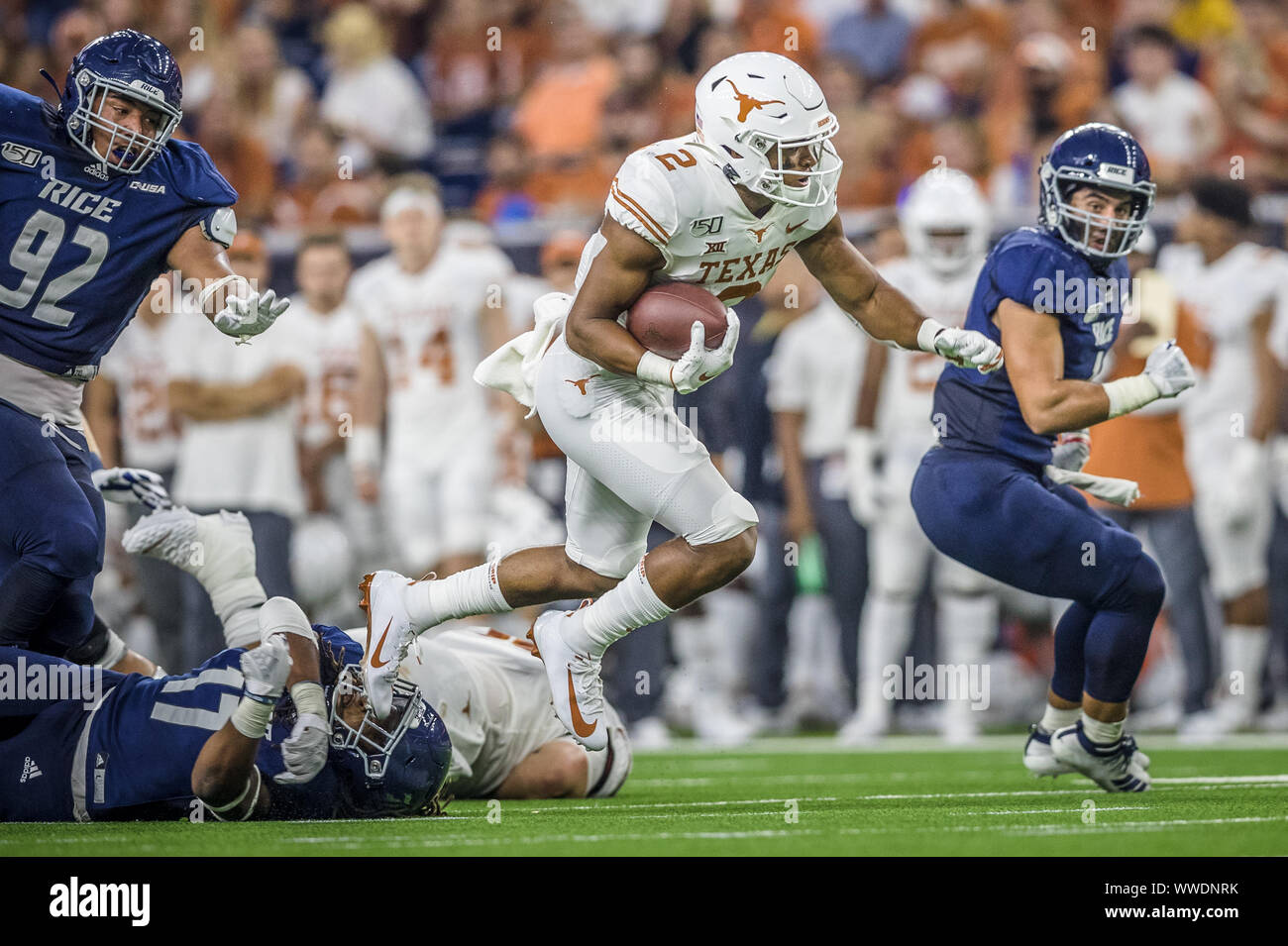 September 14, 2019: Texas Longhorns running back Roschon Johnson (2) breaks away from Rice Owls linebacker Treshawn Chamberlain (17) in the NCAA football game between the Texas Longhorns and the Rice Owls at NRG Stadium in Houston, Texas. Texas defeated Rice 48-13. Prentice C. James/CSM Stock Photo