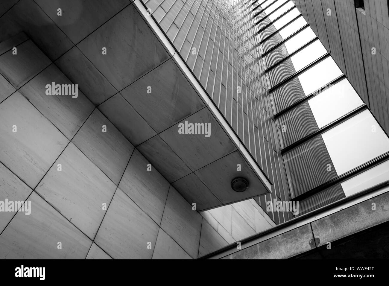 black and white close up of modern architecture in downtown Maastricht with reflections in the windows Stock Photo