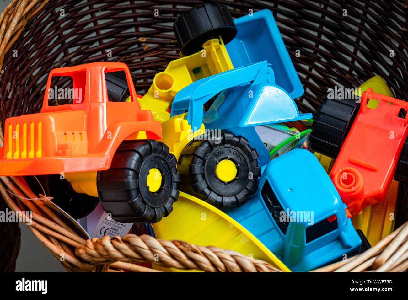 Brightly Coloured Beach Toys Outside a Souvenir Shop in the Pretty Fishing Village of Mevagissey in Cornwall UK Stock Photo