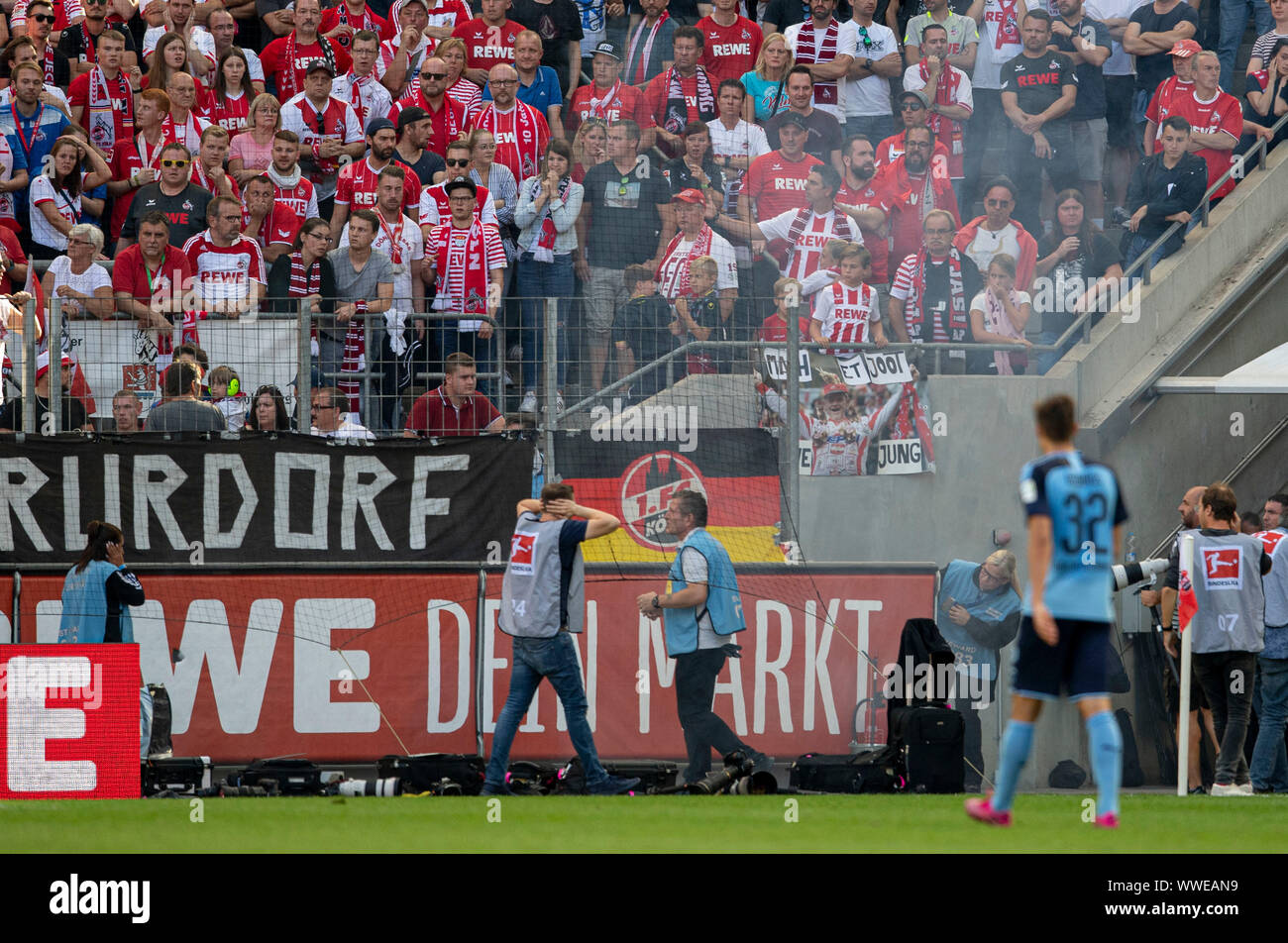 A bang explodes on the sidelines, folders and photographers hold their ears. Soccer 1. Bundesliga, 4.matchday, FC Cologne (K) - Borussia Monchengladbach (MG) 0: 1, on 14/09/2019 in Koeln/Germany. ¬ | usage worldwide Stock Photo