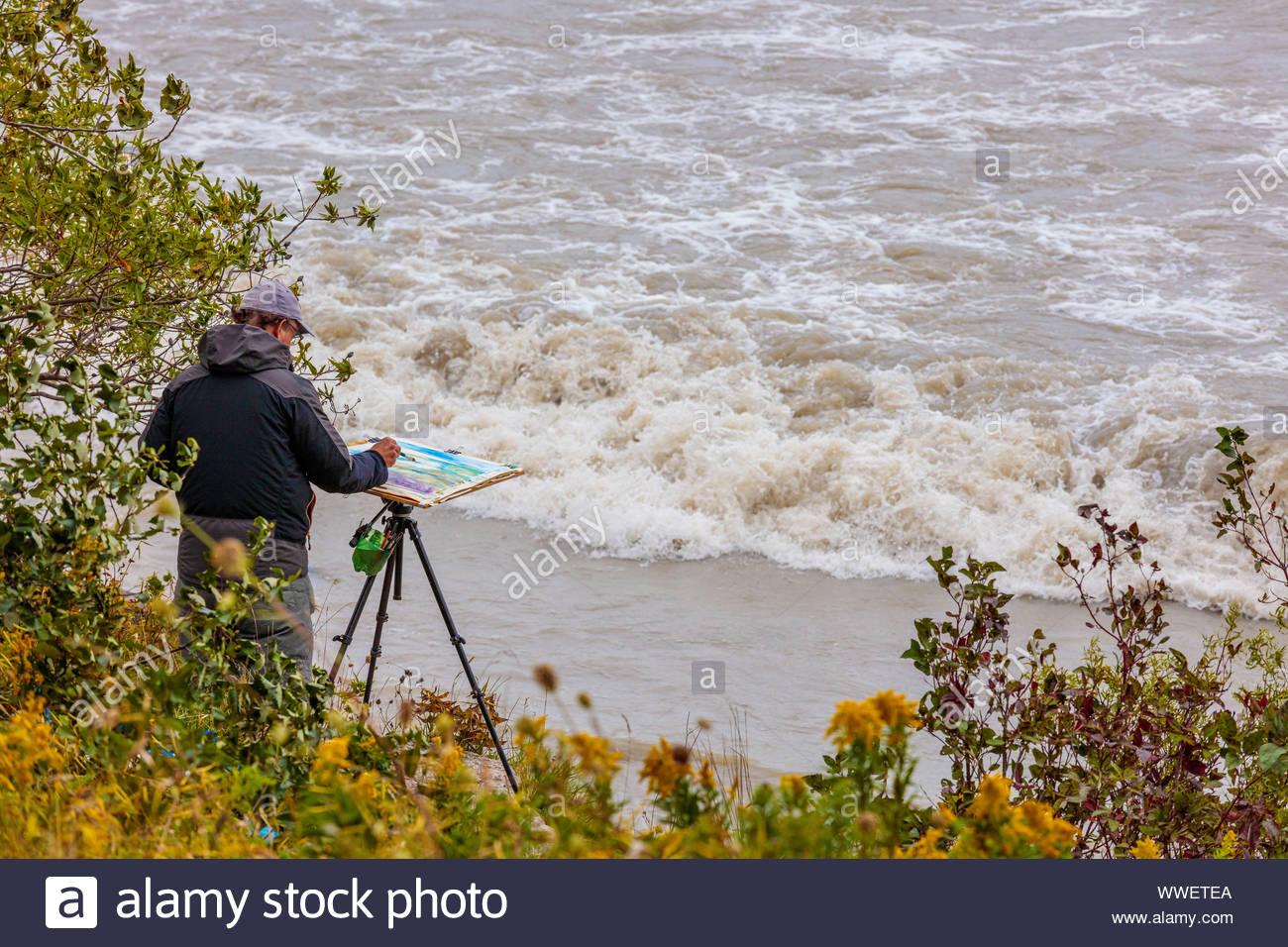Artist painting en plein air outdoors Lake Ontario in Toronto Ontario Canada Stock Photo
