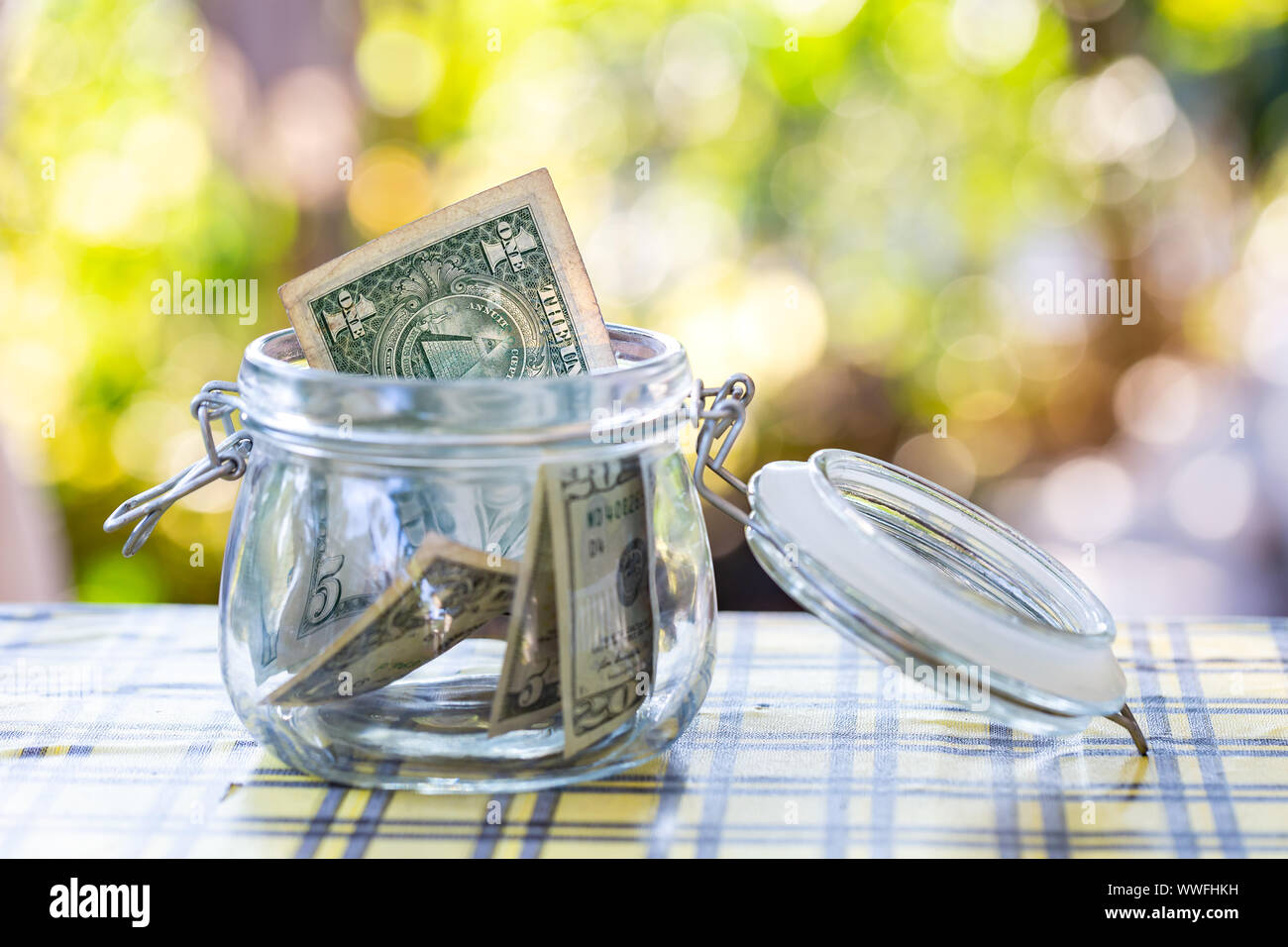 American banknote in glass jar. Stock Photo