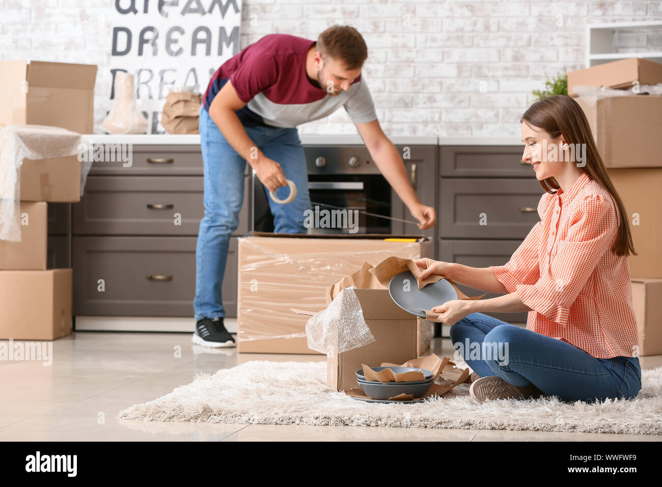 Young couple packing things before moving into new house Stock Photo